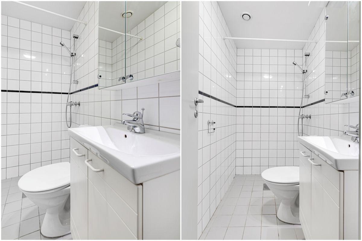 Enebakkveien 15 Pent og flislagt baderom fra 2000 med gulvvarme, dusjhjørne, toalett, servantskap og speilskap.