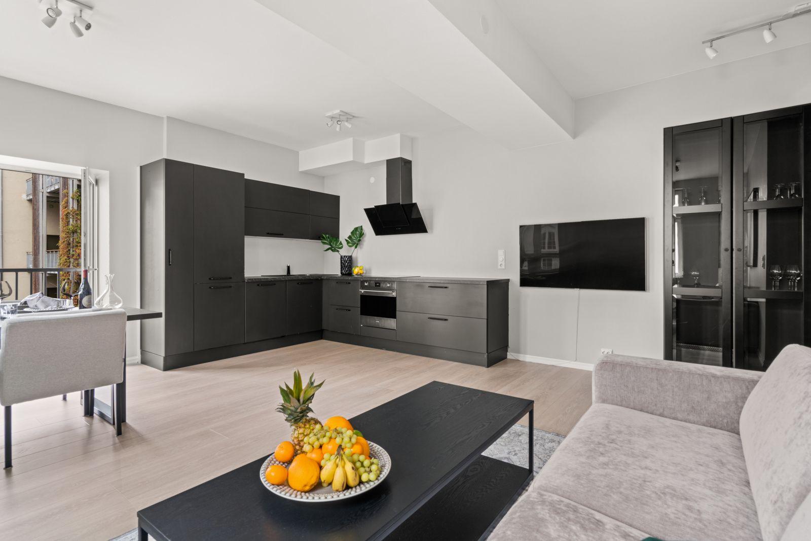 Teglverksgata 11 Kjøkkenet har en åpen løsning mot stuen som er perfekt for sosiale sammenkomster.
